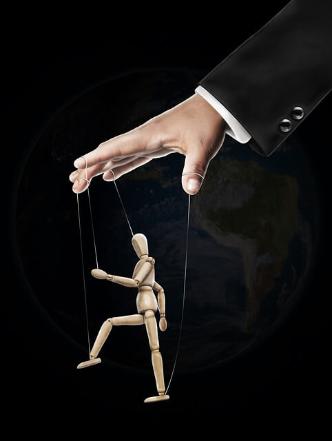 Domestically Violent man pulling the strings to a puppet depicting a controlling man who is a physical or verbal abuser