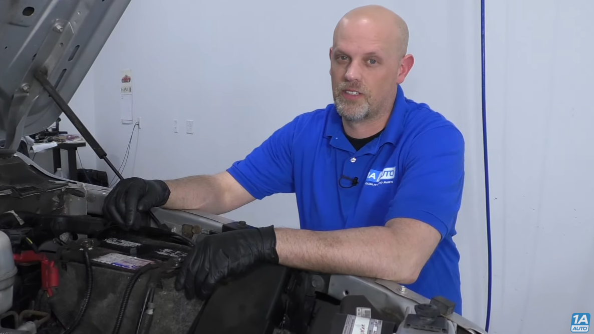 Mechanic testing the battery for charge