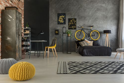 Dynamic Industrial Neutral Bedroom with Yellow Accent
