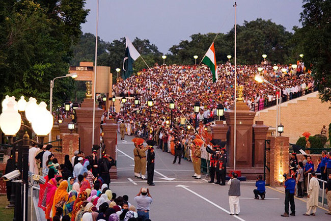 20) Pakistan and India - The Wagah border ceremony is a daily military practice that the security forces of India and Pakistan have jointly followed since 1959. It takes place every night before the flags are lowered and the gate locked on the only road between the two Asian countries.
