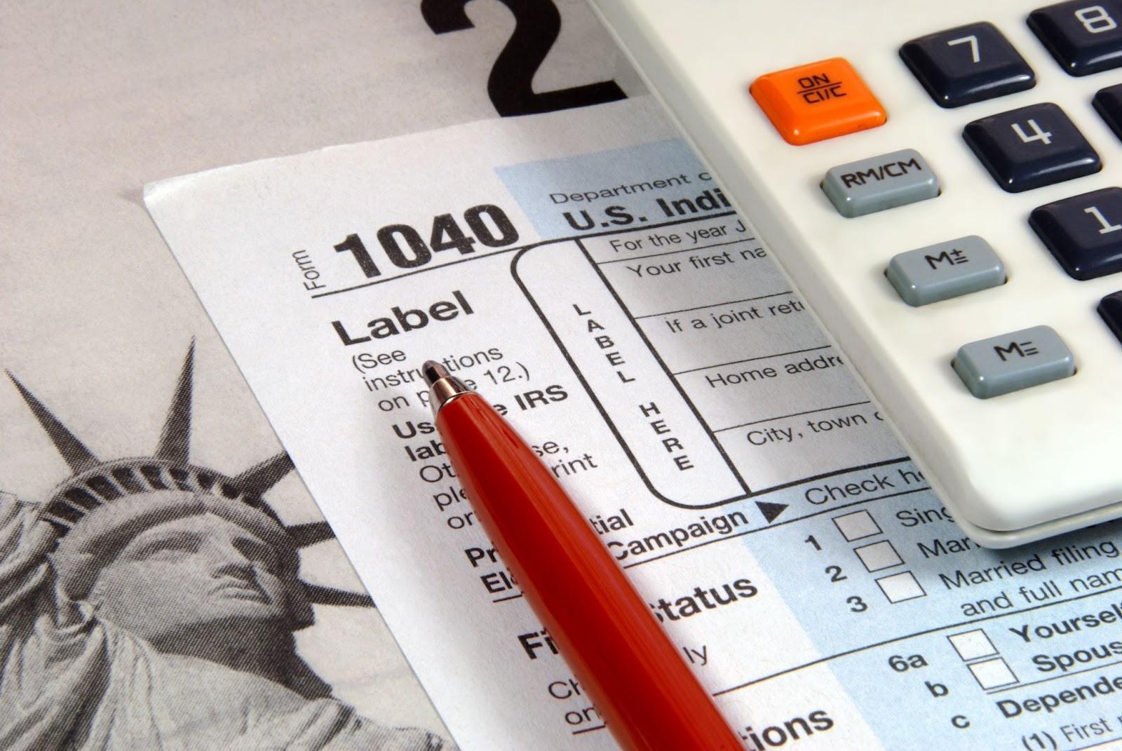 capital gains calculator, pen and a paper