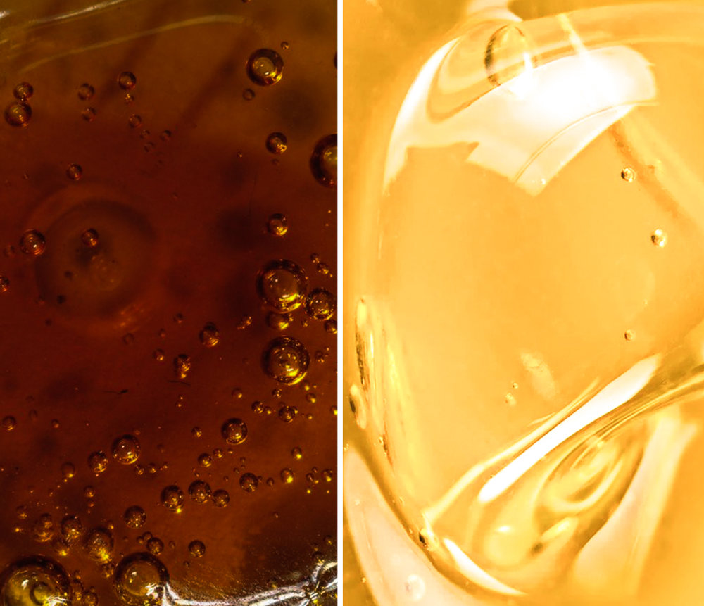 hyper close-up of two different colored cannabis oils; one dark amber, one light honey-gold