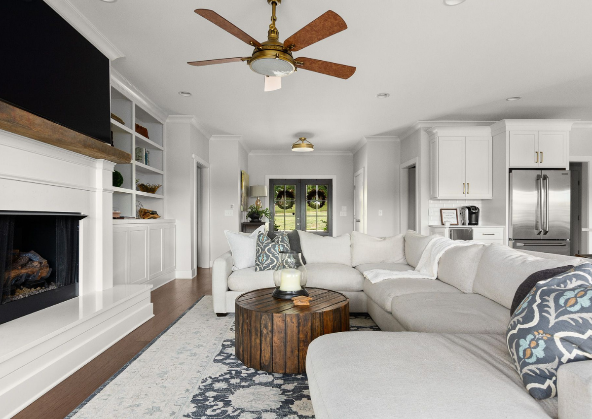 superior-construction-lebanon-tn-designer-showrooms-open-concept-living-room-large-off-white-sectional-round-coffee-table