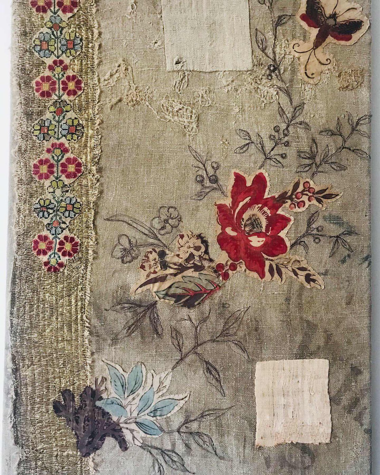 Textile picture featuring a flower