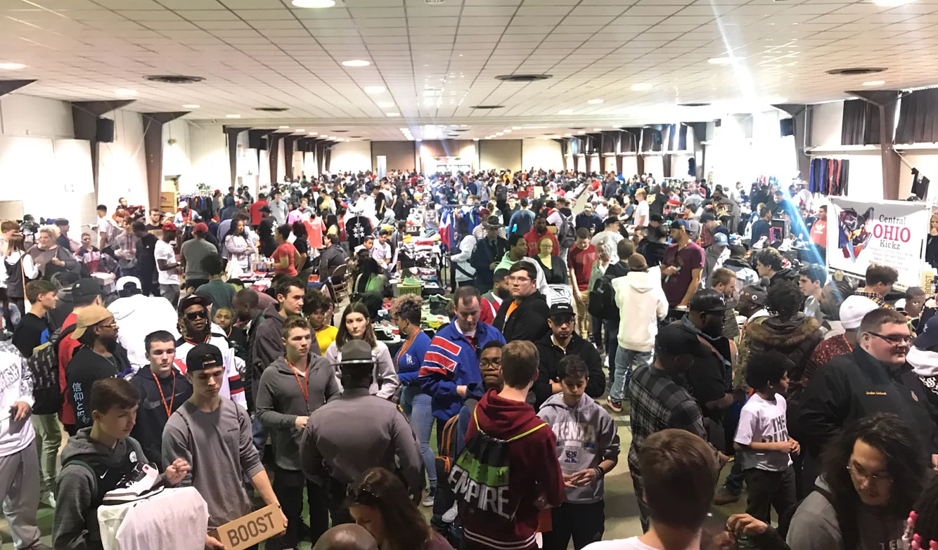 overhead view of packed sneaker convention