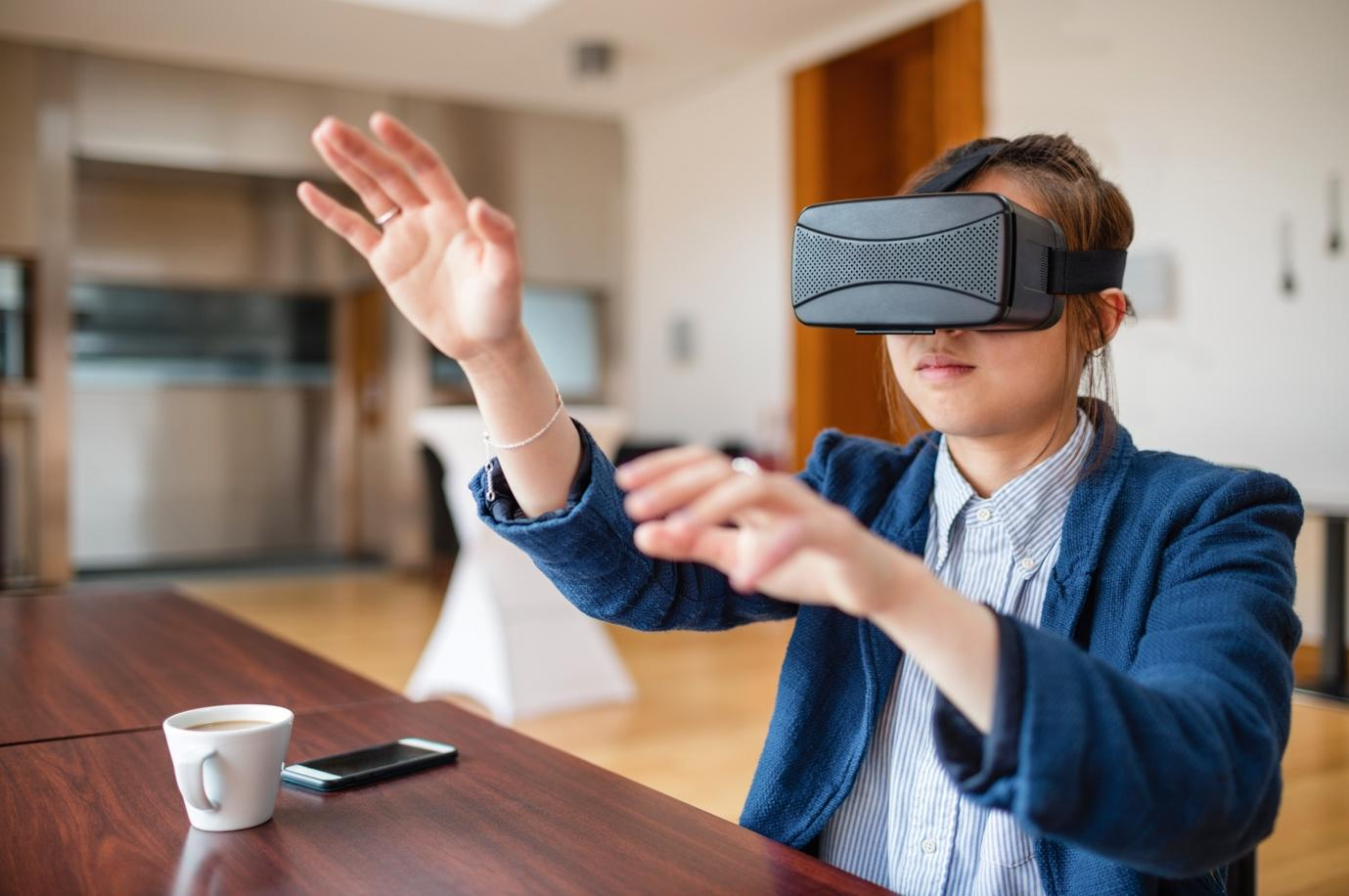 A person wearing a virtual reality headset  Description automatically generated with medium confidence