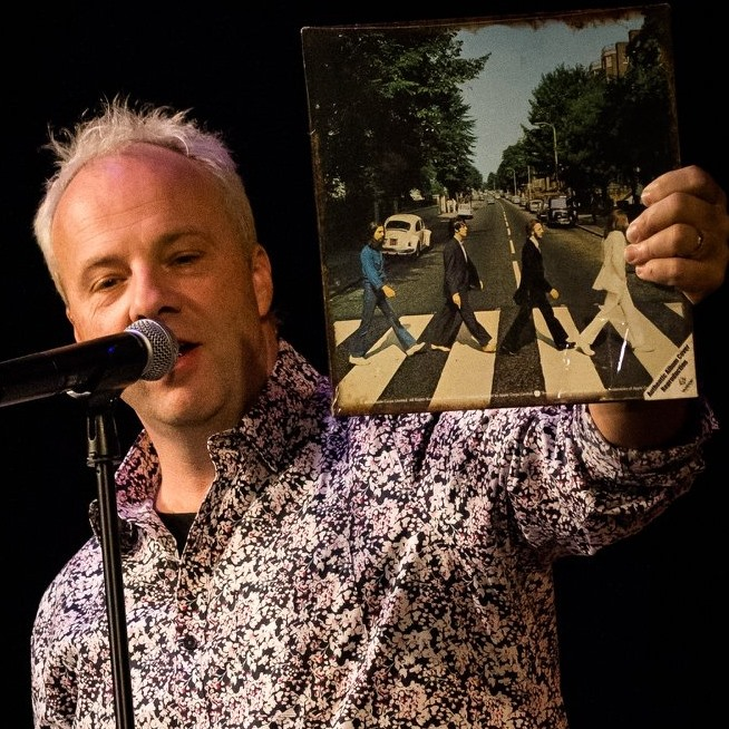 Chad Clifford of MegaBeatles holding a Beatles record