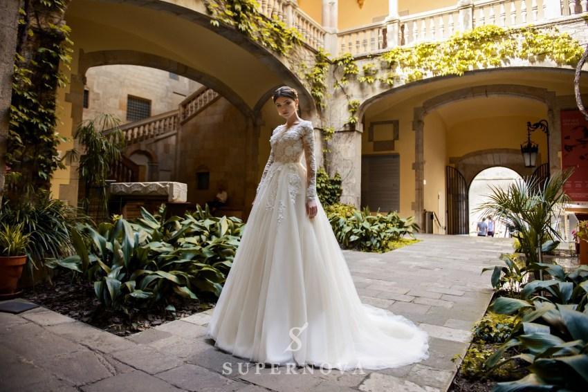 Весільні сукні з мереживними рукавами