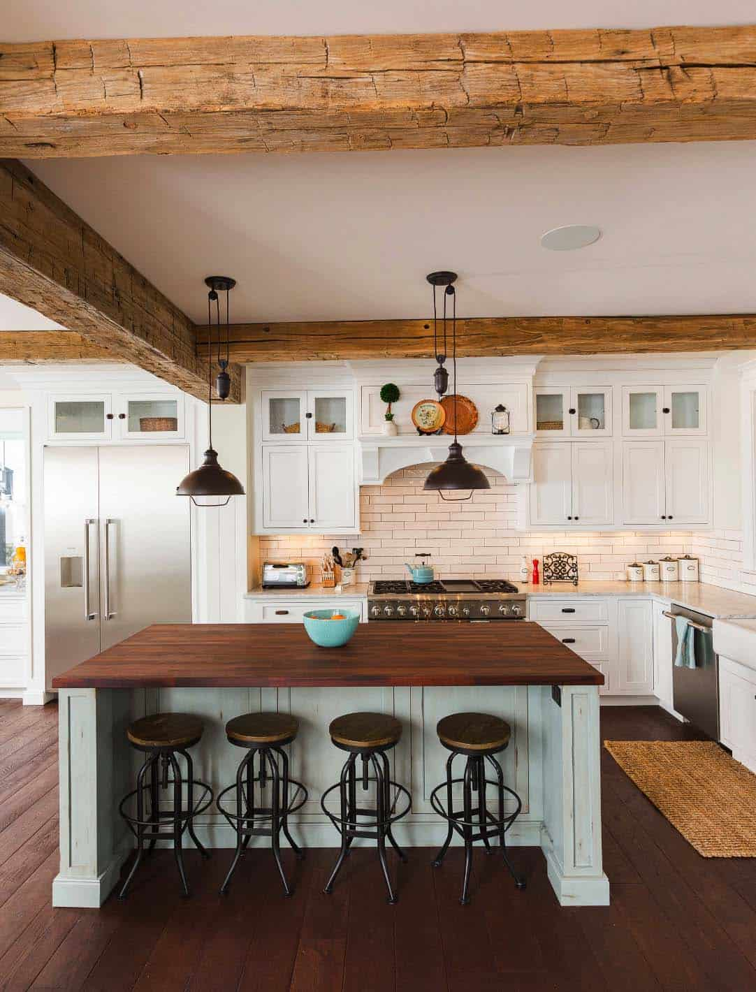 Farmhouse kitchen with white shaker cabinets, wood beams and white island