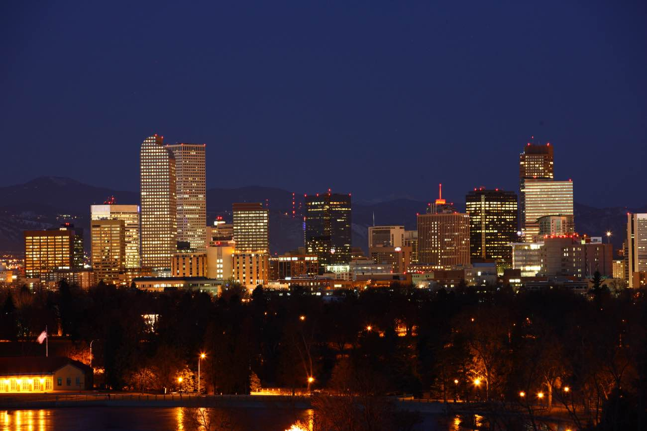 The city skyline is seen at dawn in Denver, Colorado, U.S., on Thursday, Jan. 26, 2012. Colorado will hold its Republican caucus on Feb. 7. Photographer: Matthew Staver/Bloomberg via Getty Images