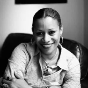 Dr. Vida Samuel smiles for a black and white photo.