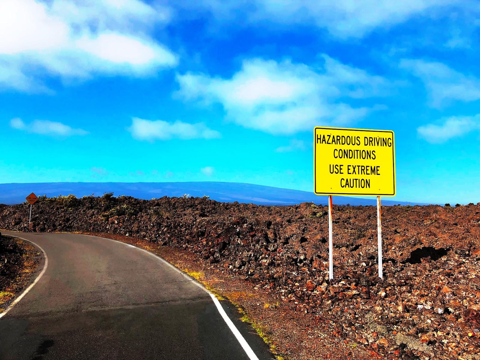 Mauna Loa Observatory hazard sign on bike climb to the summit