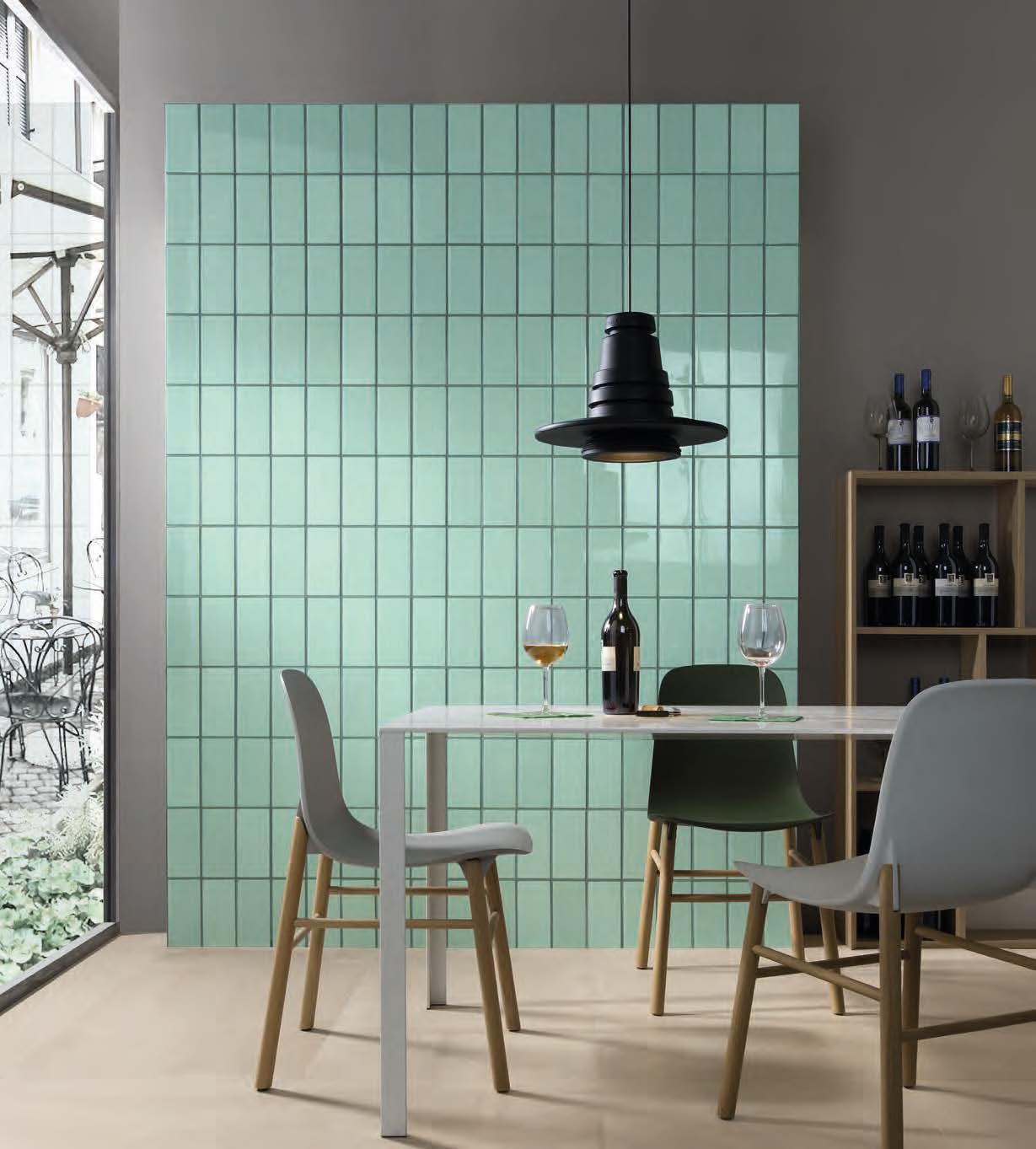 Pastel aqua tile wall in a vertical grid