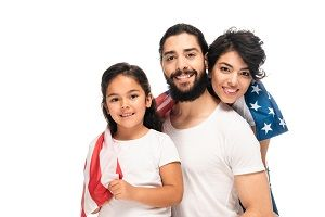 A Hispanic immigrant family with a US flag