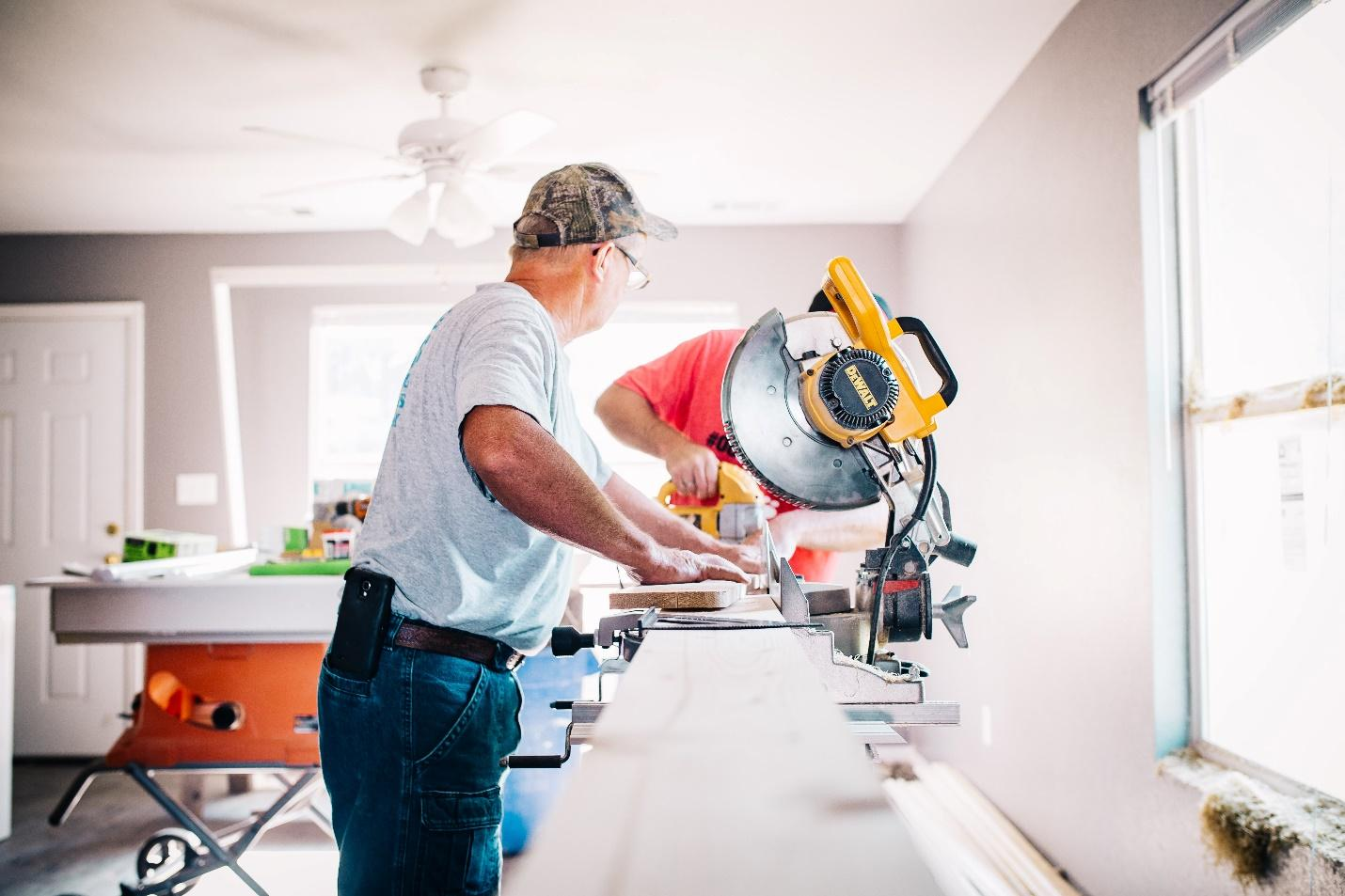 Two people working on a home improvement project