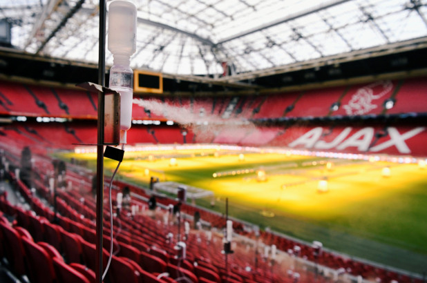 Scientists spray saliva-like droplets in stadium to study how fans spread aerosols