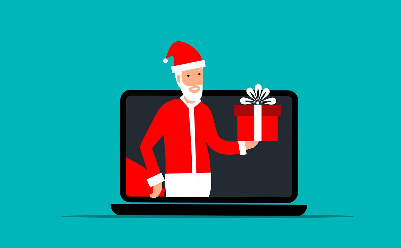 Cartoon of santa presenting a gift through a computer screen