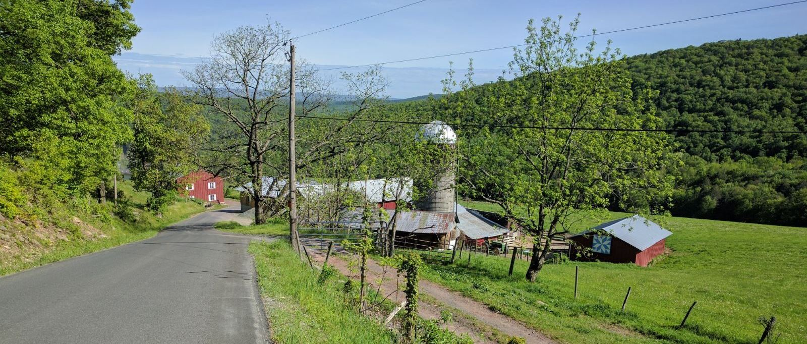 Bicycle climb up Glade Hill - silo , barn, farmhouse, road, forest