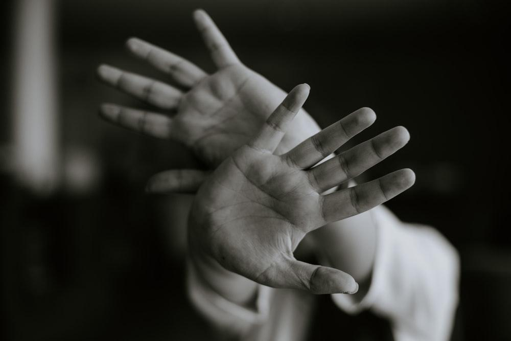 person stretching their hands