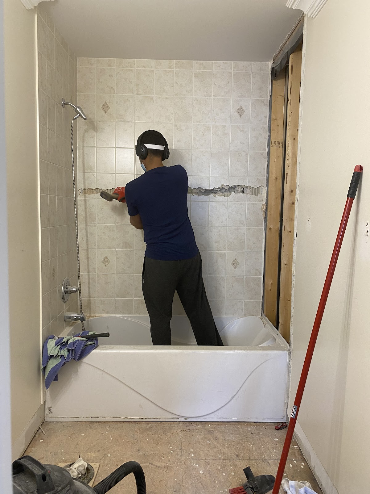 Smash shower tiles across the middle to remove them