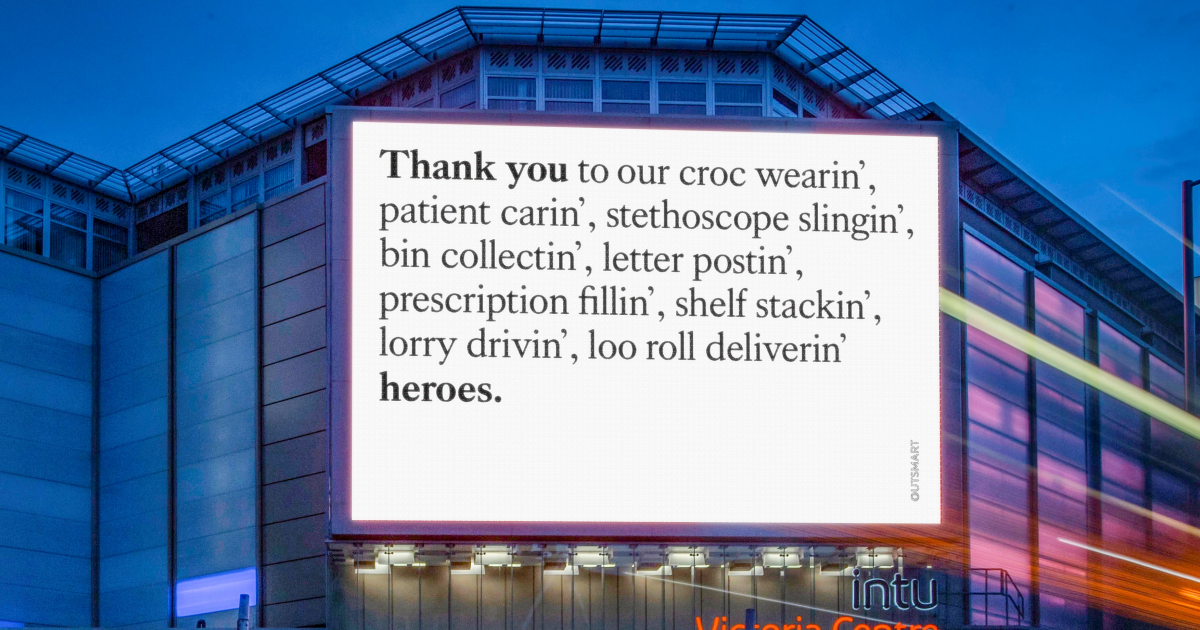 """Digital billboard with plain white background and the text """"Thank you to our croc wearin', patient carin', stethoscope colelctin', letter postin', prescription filling', shelf stackin', lorry drivin', loo roll deliverin' heroes."""""""