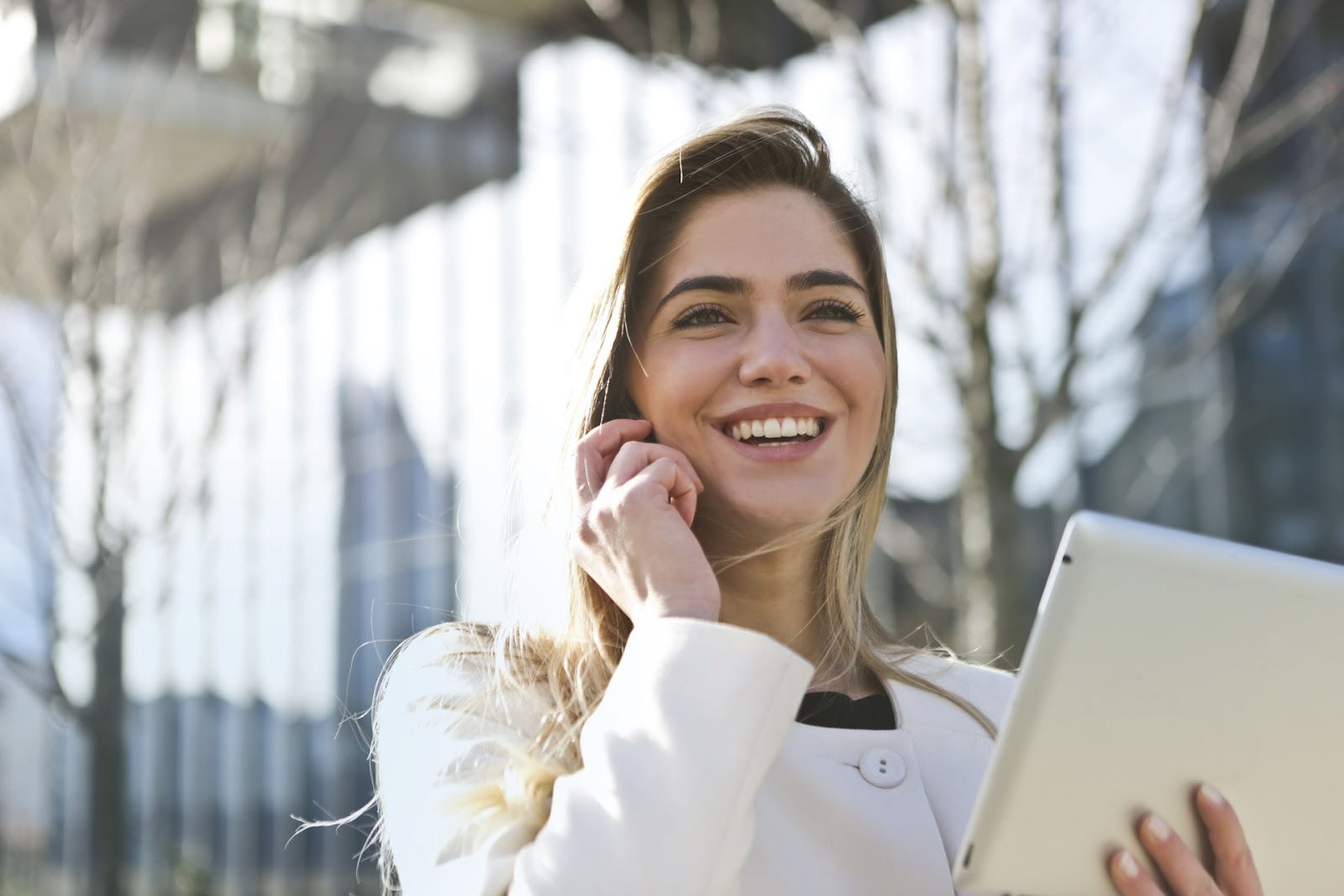 woman on cell phone feeling great at work