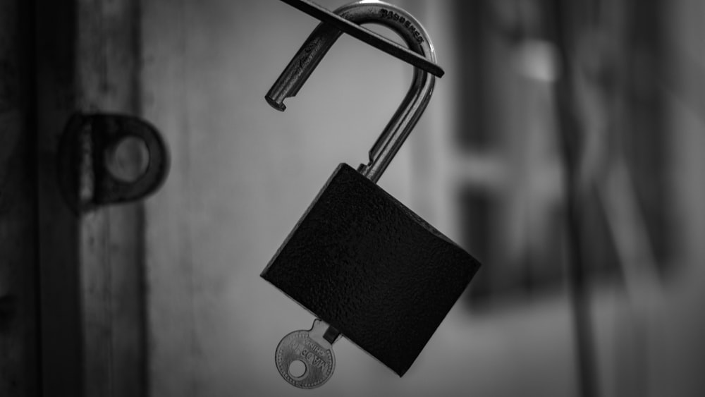 black and silver padlock in grayscale photography