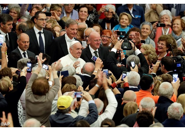Pope Francis arrives to meet an association of elderly workers during a special audience he granted them in the Pope Paul VI hall, at the Vatican, Saturday, Oct. 15, 2016 - AP