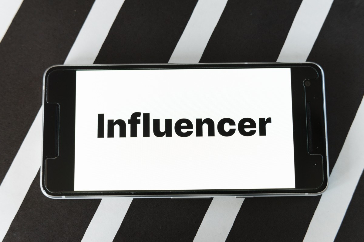 "Mobile with ""influencer"" on screen 