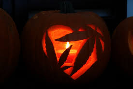 pot leaves carved into a pumpkin