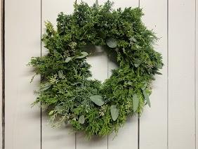 Featuring fresh juniper, pine, cedar, eucalyptus and more. This wreath smells incredible!