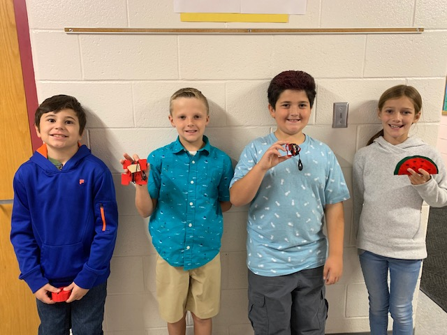 students with their inventions
