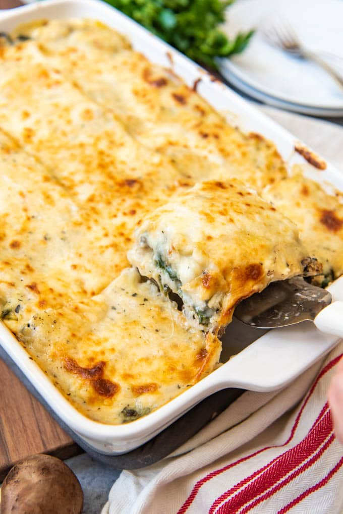 Layers of lean ground chicken and mushrooms, spinach, a creamy white sauce, lasagna noodles, and cheese, make this White Chicken Spinach Lasagna a bit lighter than the traditional version while still being loaded with delicious, comforting flavor!