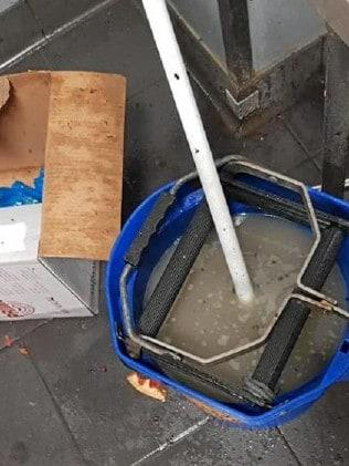 A mop sits in rancid water.