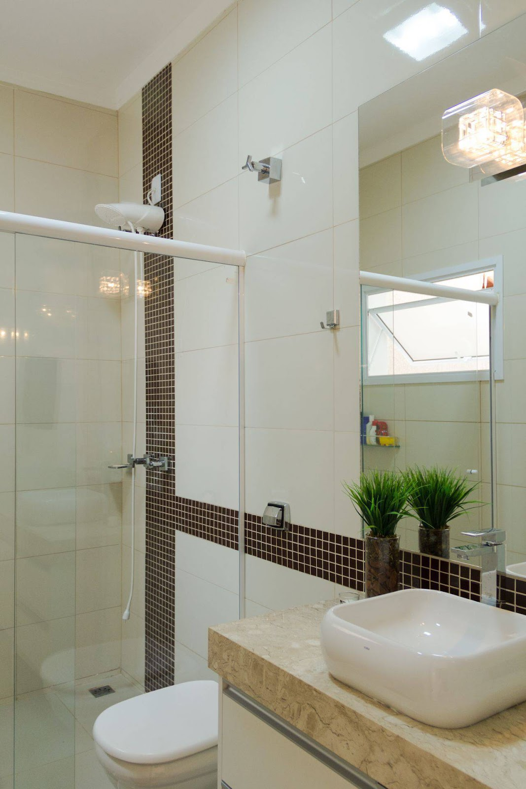 image of a complete bathroom, it is possible to identify sink, toilet and shower.