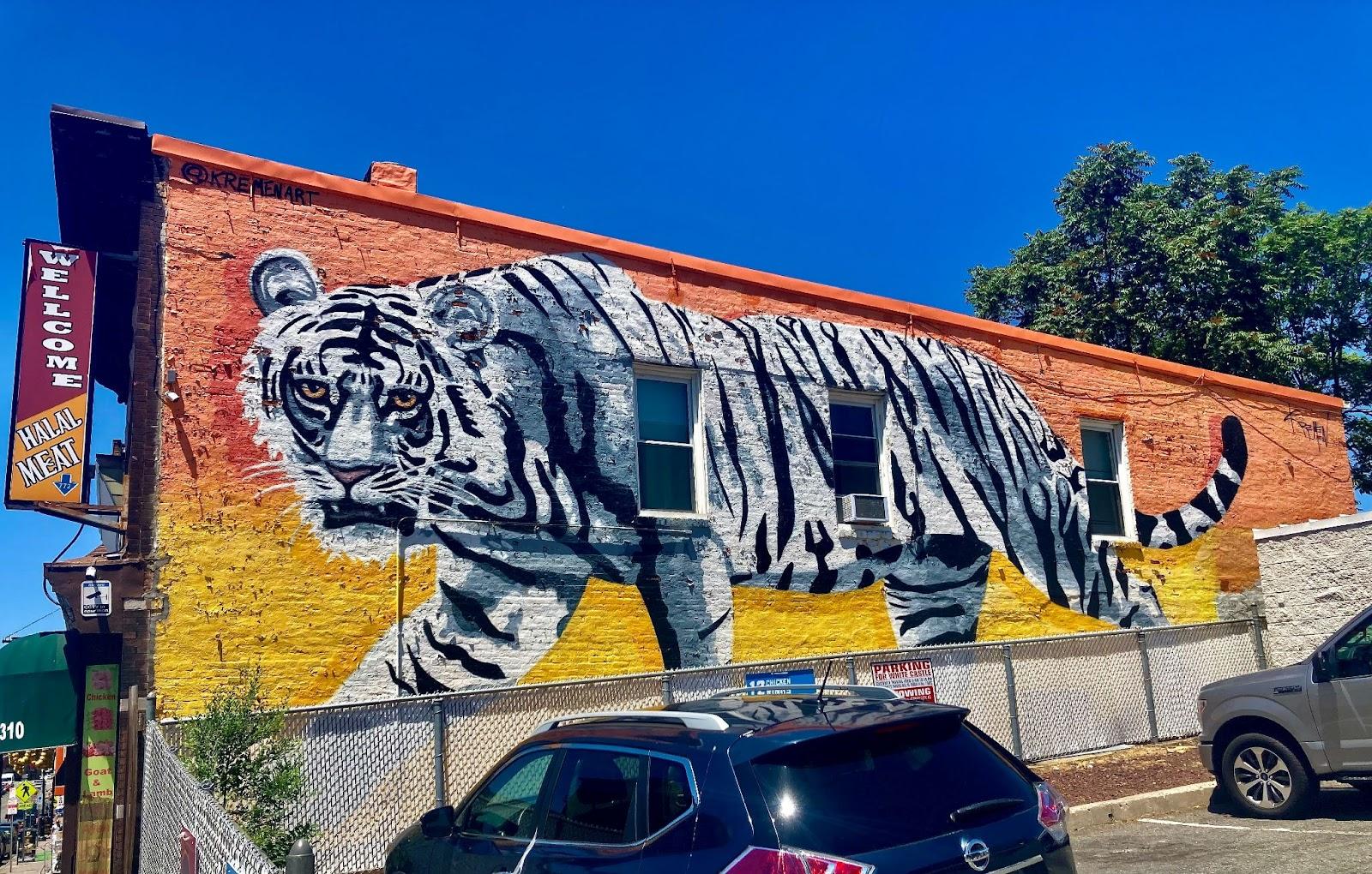 "Inside Look at Jersey City's Burgeoning Street Art. ""Sunset Tiger"" by Kremen Art. 2995 John F. Kennedy Blvd. Photo by Vittoria Benzine."