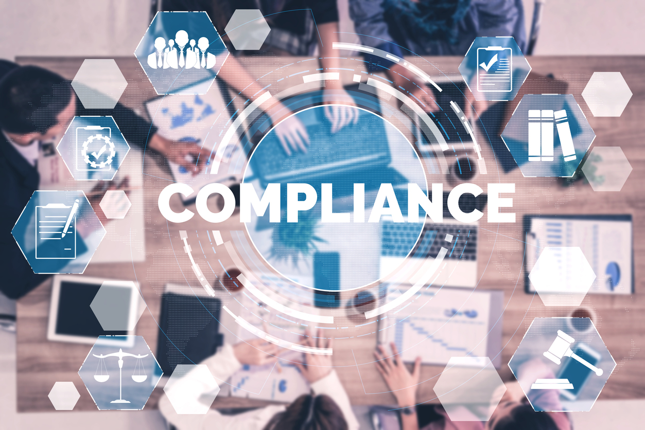 Various devices and icons representing the complexity of compliance, just one reason to consider if your business should migrate from G Suite to Microsoft 365.