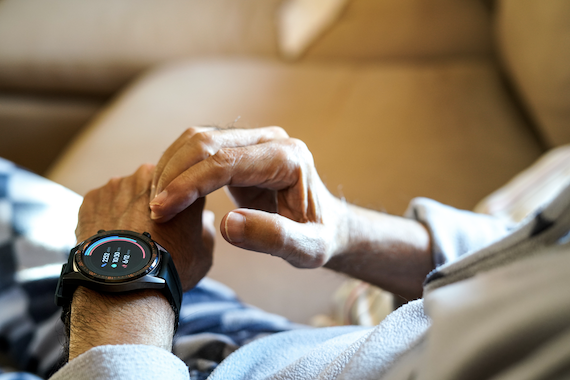 mental health technology: Man checking his smart watch