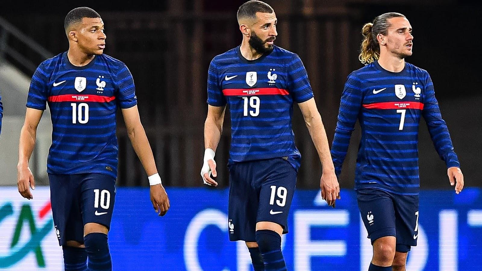 Kylian Mbappe, Karim Benzema, and Antoine Griezmann in France jerseys