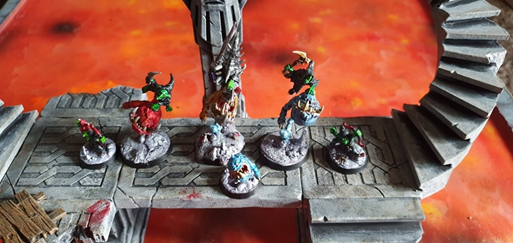 A Gloomspite Gizt bounderz warband on painted stone walkways with lava board underneath.