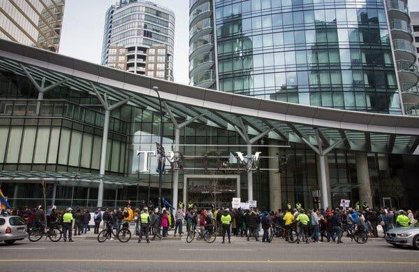 Protesters outside the Trump International Hotel & Tower in Vancouver, British Columbia, a property that has attracted Chinese buyers.