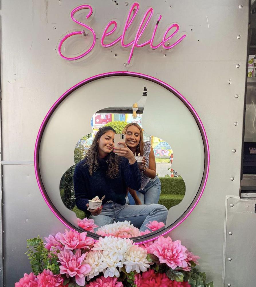 Maria Paula Rodriguez | Taking a photo through a selfie mirror