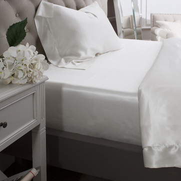 Ivory silk fitted sheet.