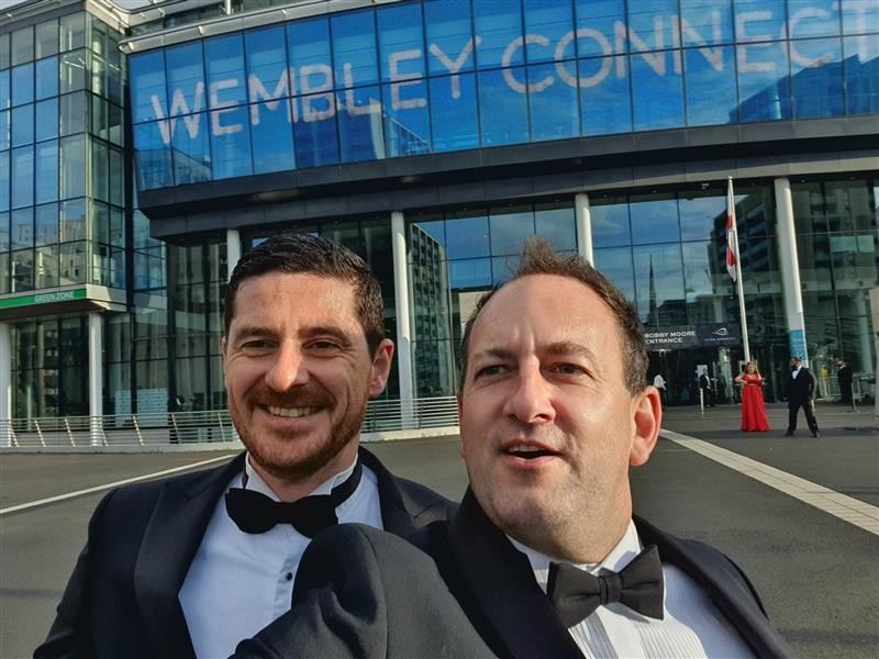 Ryan and Rob in their tux's in front of Wembley Stadium