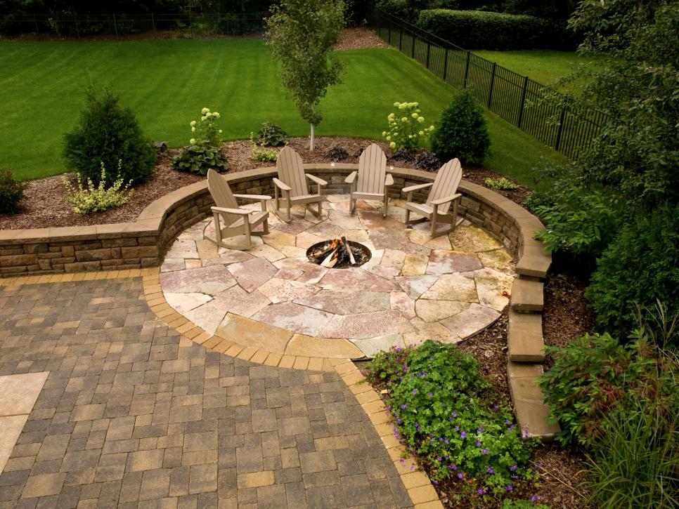 stone patio with fire-pit and matching chair sets