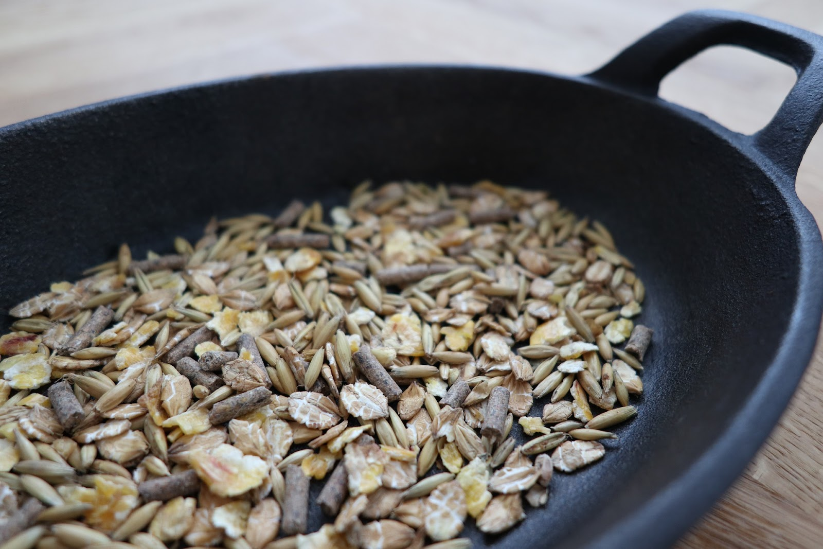 A pan holding a grain/ pelleted feed mix