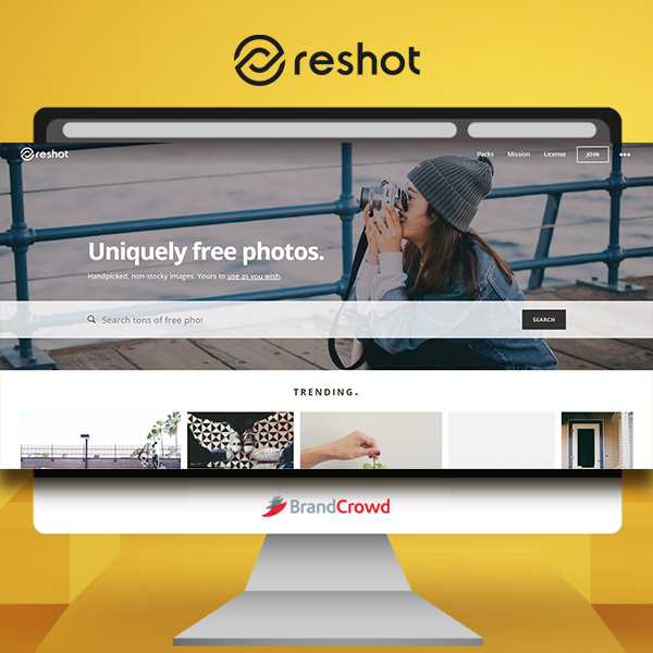 the-photo-features-a-monitor-displaying-the-landing-page-of-reshot