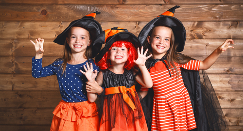 three girls dressed as witches
