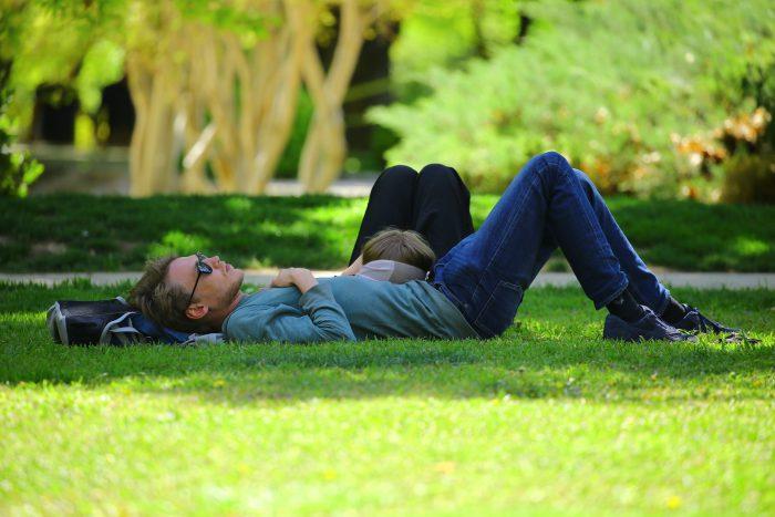 man-wearing-blue-long-sleeve-shirt-lying-on-ground-during-170171