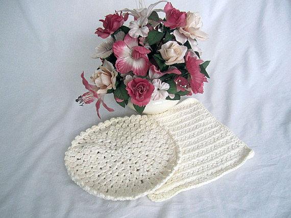 Two off-white dishcloths